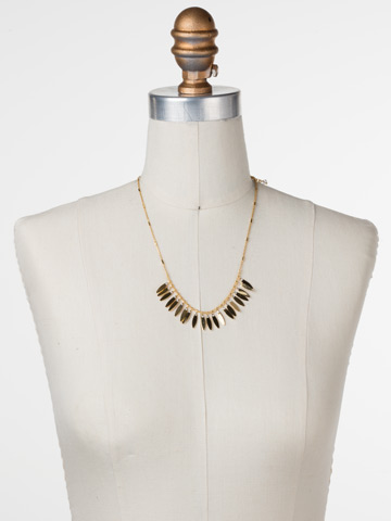 Feathered Fringe Necklace in Bright Gold-tone Crystal displayed on a necklace bust