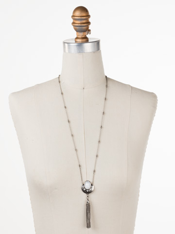 Plated Tassel Necklace in Antique Silver-tone White Howlite displayed on a necklace bust
