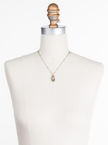Nostalgic Navette Pendant in Antique Gold-tone Neutral Territory displayed on a necklace bust