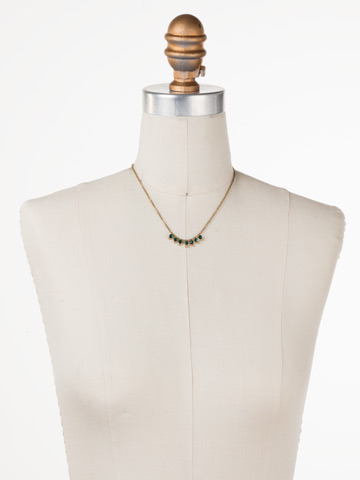 Delicate Dots Necklace in Antique Gold-tone Emerald displayed on a necklace bust