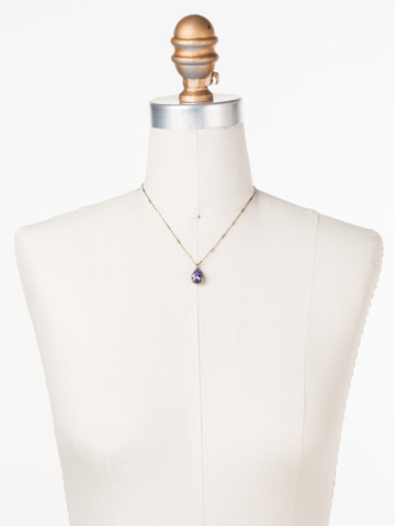 Simply Adorned Pendant in Antique Gold-tone Jewel Tone displayed on a necklace bust
