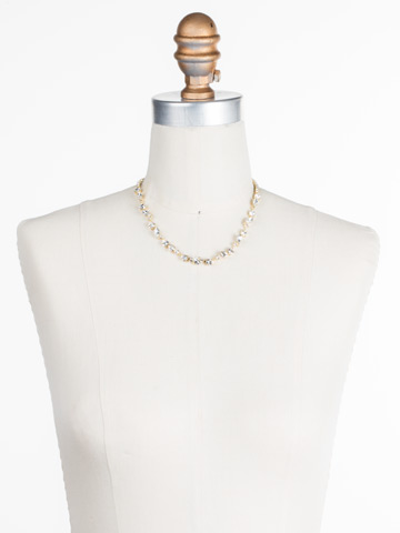 Simply Stated Line Necklace in Bright Gold-tone Crystal displayed on a necklace bust