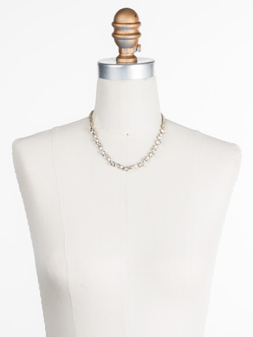 Dazzling Diamonds Line Necklace in Antique Gold-tone Crystal displayed on a necklace bust