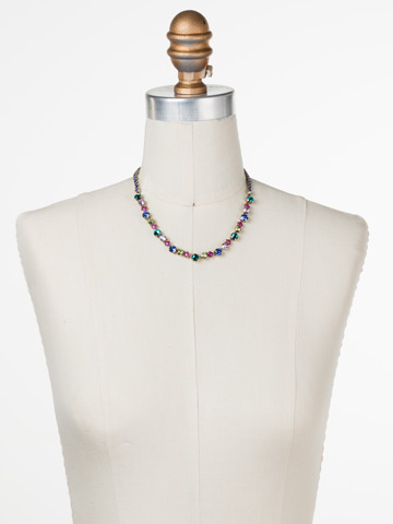 Dazzling Diamonds Line Necklace in Antique Gold-tone Wildflower displayed on a necklace bust