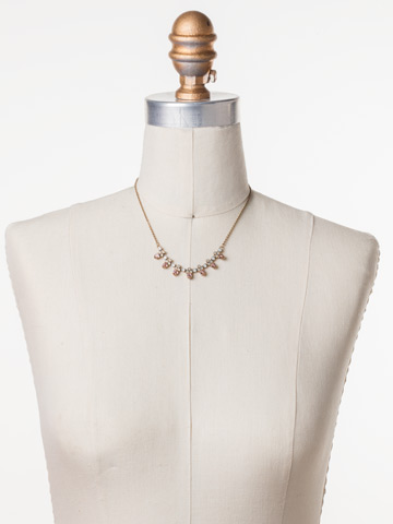 Twinkling Thistle Necklace in Antique Gold-tone Pink Peony displayed on a necklace bust