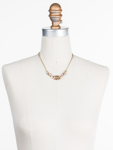 Crystal Crysathemum Necklace in Antique Gold-tone Neutral Territory displayed on a necklace bust