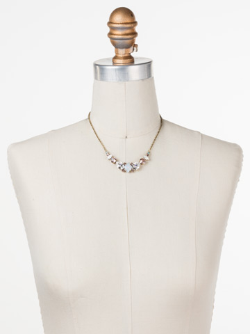 Crystal Crysathemum Necklace in Antique Gold-tone White Magnolia displayed on a necklace bust