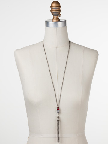 Timeless Tassel Necklace in Antique Silver-tone Crimson Pride displayed on a necklace bust