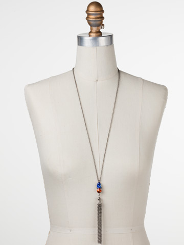Timeless Tassel Necklace in Antique Silver-tone Orange Crush displayed on a necklace bust