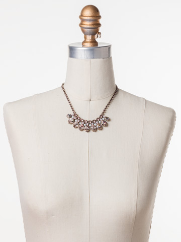 Precious Petals Necklace in Antique Gold-tone Pink Peony displayed on a necklace bust