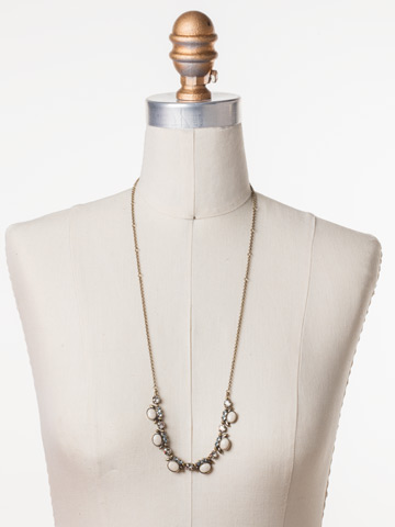 Semi-Charmed Necklace in Antique Gold-tone Coastal Mist displayed on a necklace bust