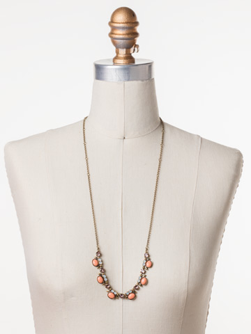 Semi-Charmed Necklace in Antique Gold-tone Pink Peony displayed on a necklace bust