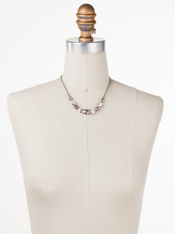 Polished Pear Necklace in Antique Silver-tone Crystal Rose displayed on a necklace bust