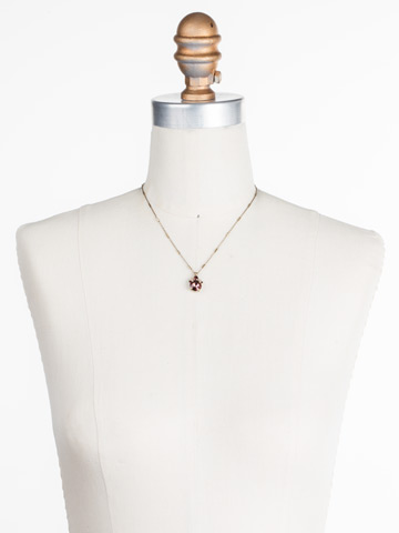 Crowning Around Necklace in Antique Gold-tone Mighty Maroon displayed on a necklace bust