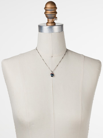 Crowning Around Necklace in Antique Silver-tone Battle Blue displayed on a necklace bust