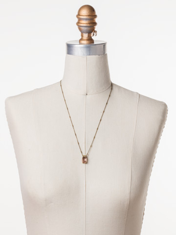 Singular Sensation Pendant in Antique Gold-tone Rustic Bloom displayed on a necklace bust