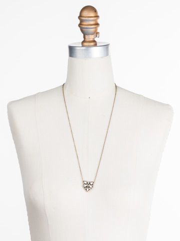 Mini Medalion Pendant Necklace in Antique Gold-tone Crystal displayed on a necklace bust
