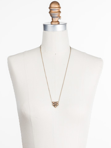 Mini Medalion Pendant Necklace in Antique Gold-tone Neutral Territory displayed on a necklace bust
