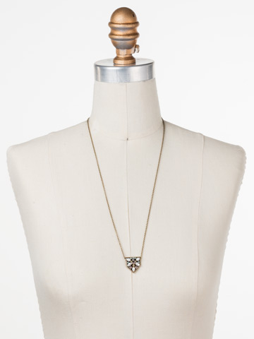 Mini Medalion Pendant Necklace in Antique Gold-tone White Magnolia displayed on a necklace bust