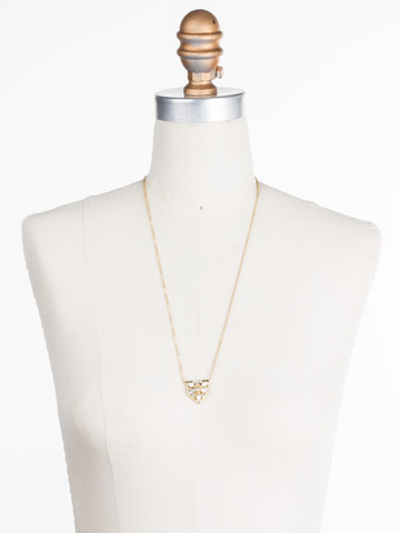 Mini Medalion Pendant Necklace in Bright Gold-tone Crystal displayed on a necklace bust