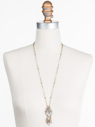 Brilliant Boho Pendant in Antique Gold-tone Crystal displayed on a necklace bust