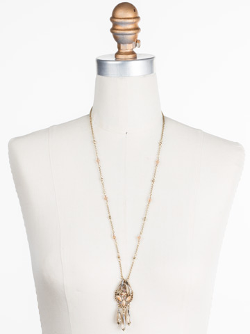 Brilliant Boho Pendant in Antique Gold-tone Neutral Territory displayed on a necklace bust