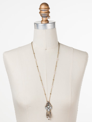 Brilliant Boho Pendant in Antique Gold-tone White Magnolia displayed on a necklace bust