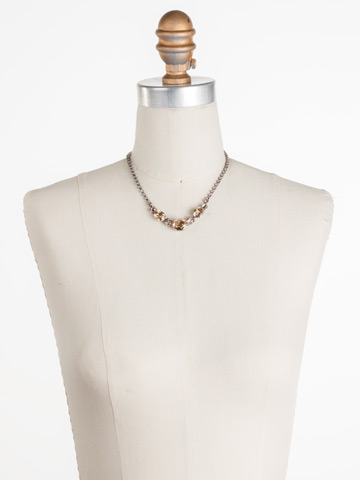 Standing Ovation Necklace in Antique Silver-tone Satin Blush displayed on a necklace bust