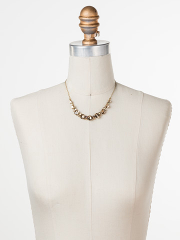 Divide and Conquer Necklace in Antique Gold-tone Neutral Territory displayed on a necklace bust