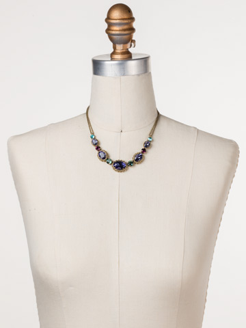 Camellia Necklace in Antique Gold-tone Jewel Tone displayed on a necklace bust
