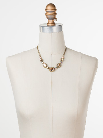 Camellia Necklace in Antique Gold-tone Neutral Territory displayed on a necklace bust