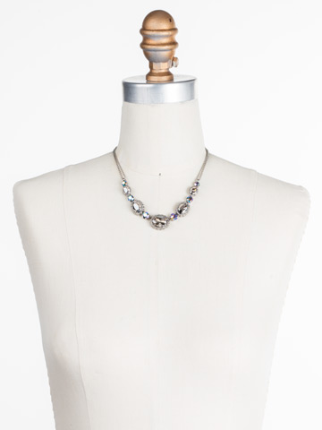 Camellia Necklace in Antique Silver-tone Crystal Rock displayed on a necklace bust