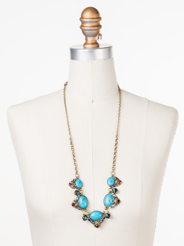 Flora Filigree Necklace in Antique Gold-tone Jewel Tone displayed on a necklace bust