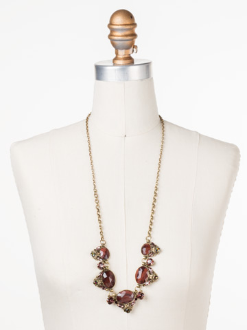 Flora Filigree Necklace in Antique Gold-tone Mahogany displayed on a necklace bust