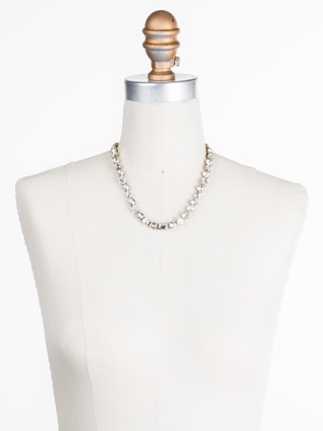 Tansy Line Necklace in Antique Gold-tone Crystal displayed on a necklace bust