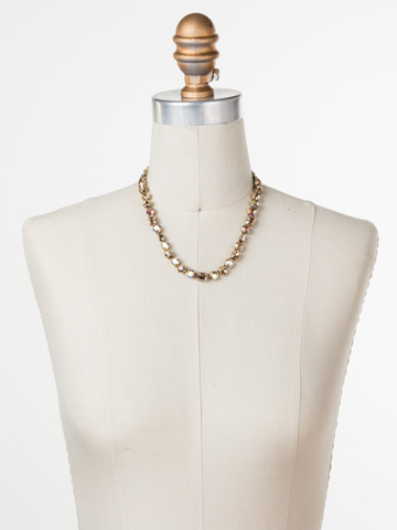 Tansy Line Necklace in Antique Gold-tone Neutral Territory displayed on a necklace bust