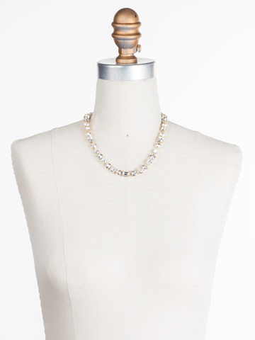 Tansy Line Necklace in Bright Gold-tone Crystal displayed on a necklace bust