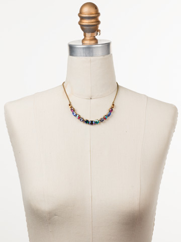 Tansy Half Line Necklace in Antique Gold-tone Game of Jewel Tones displayed on a necklace bust