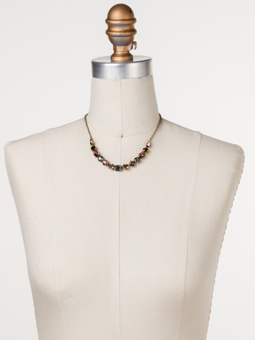 Tansy Half Line Necklace in Antique Gold-tone Mahogany displayed on a necklace bust