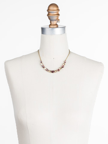 Tansy Half Line Necklace in Antique Gold-tone Mighty Maroon displayed on a necklace bust