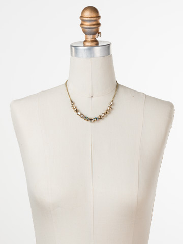 Tansy Half Line Necklace in Antique Gold-tone Neutral Territory displayed on a necklace bust