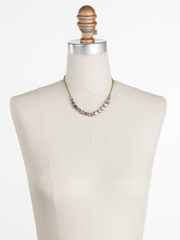 Tansy Half Line Necklace in Antique Gold-tone Washed Waterfront displayed on a necklace bust