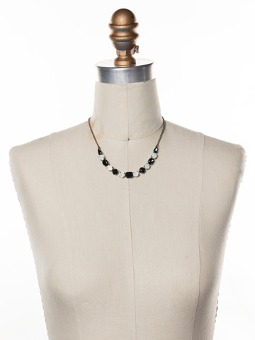 Tansy Half Line Necklace in Antique Silver-tone Glory Blue displayed on a necklace bust