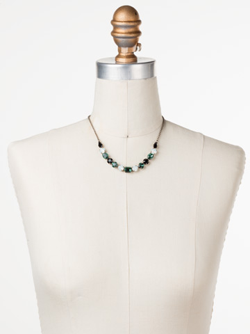Tansy Half Line Necklace in Antique Silver-tone Game Day Green displayed on a necklace bust
