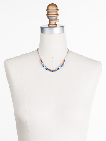 Tansy Half Line Necklace in Antique Silver-tone Orange Crush displayed on a necklace bust