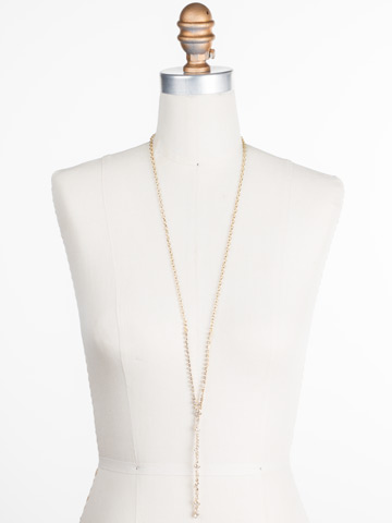Honeysuckle Lariat Necklace in Bright Gold-tone Crystal displayed on a necklace bust