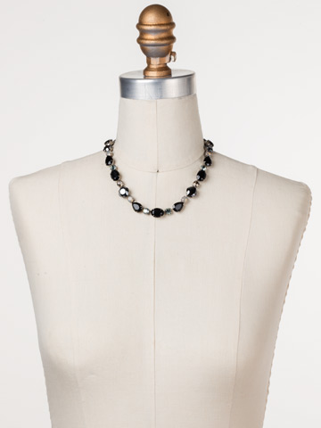 Narcissus Necklace in Antique Silver-tone Black Onyx displayed on a necklace bust