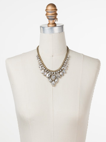 Protea Statement Necklace in Antique Gold-tone Crystal displayed on a necklace bust