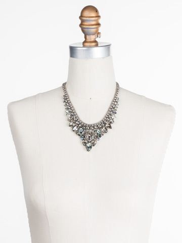 Protea Statement Necklace in Antique Silver-tone Crystal Rock displayed on a necklace bust