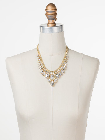 Protea Statement Necklace in Bright Gold-tone Crystal displayed on a necklace bust